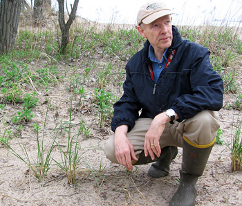Jim Bissell points out dune grasses at Presque Isle