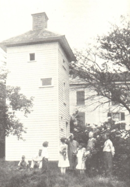 Althea Sherman (left) and her sister Amerlia show Althea's chimney swift tower to visiting schoolchildren