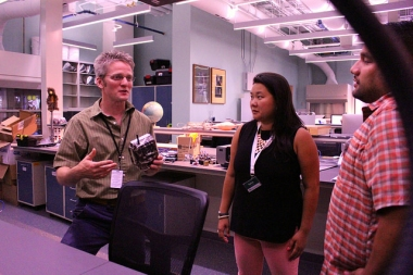 Roland Kays explains to a couple helpers how camera traps work at the North Carolina Museum of Natural Sciences