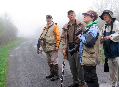 Watching and listening for birds in the fog at SGL 300, left to right, Mike Jackson, David Trently, Laura Jackson, the author
