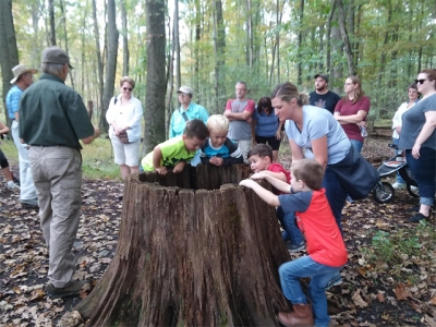 Young and old enjoying a walk in the woods at the Montour Preserve, Montour County