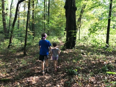 Two young people participating in a Walk in the Woods at the Wolf Creek Narrows Natural Area in Butler County